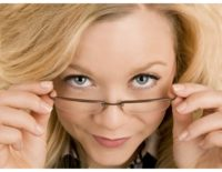 Woman looking at you with wary eyes about trusting your gut and the importance of learning how to do it successfully.