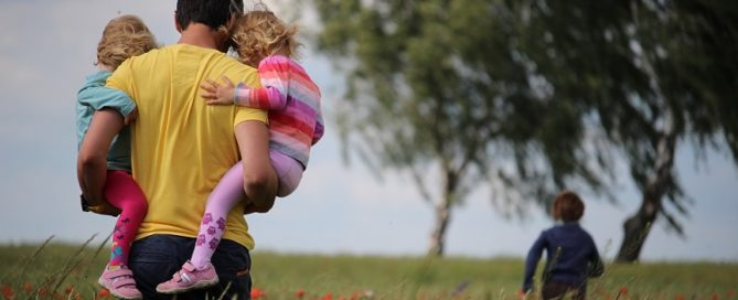 Dad walking with kids teaching them emotional honesty.
